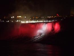 picture of Niagara Falls at night with red lights