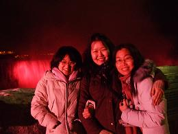 picture of Interns at Niagara Falls at night with red lights