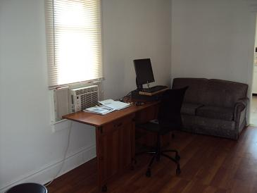 picture of student residence house computer and couch